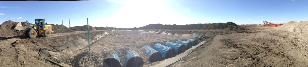 Installing a storm water storage system at a Regina Costco.